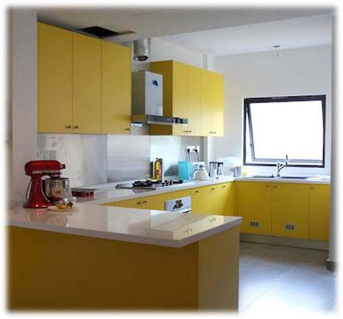 Yellow and White Kitchen Cabi Design with U shaped Kitchen Layout